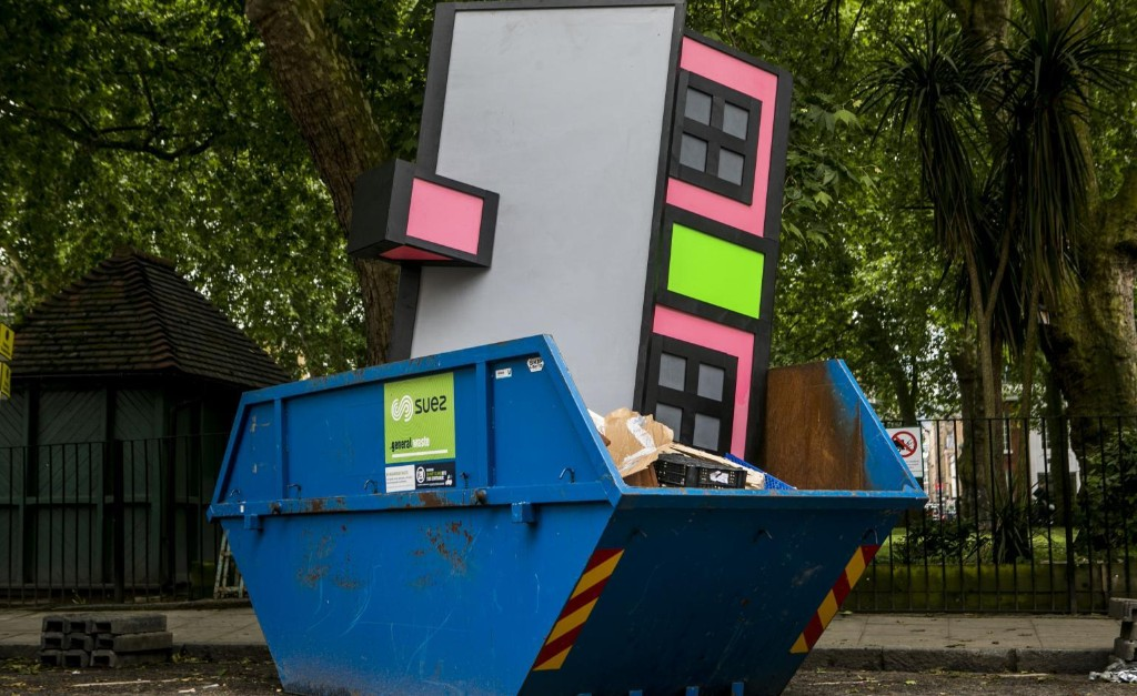 Richard Woods casts a cartoon house into a skip in east London