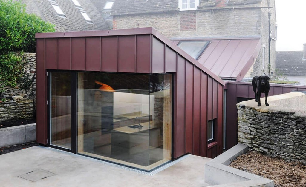 Rose-coloured zinc extension elevates an old English house