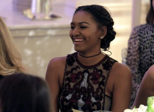 Sasha and Malia Obama attend their first state dinner