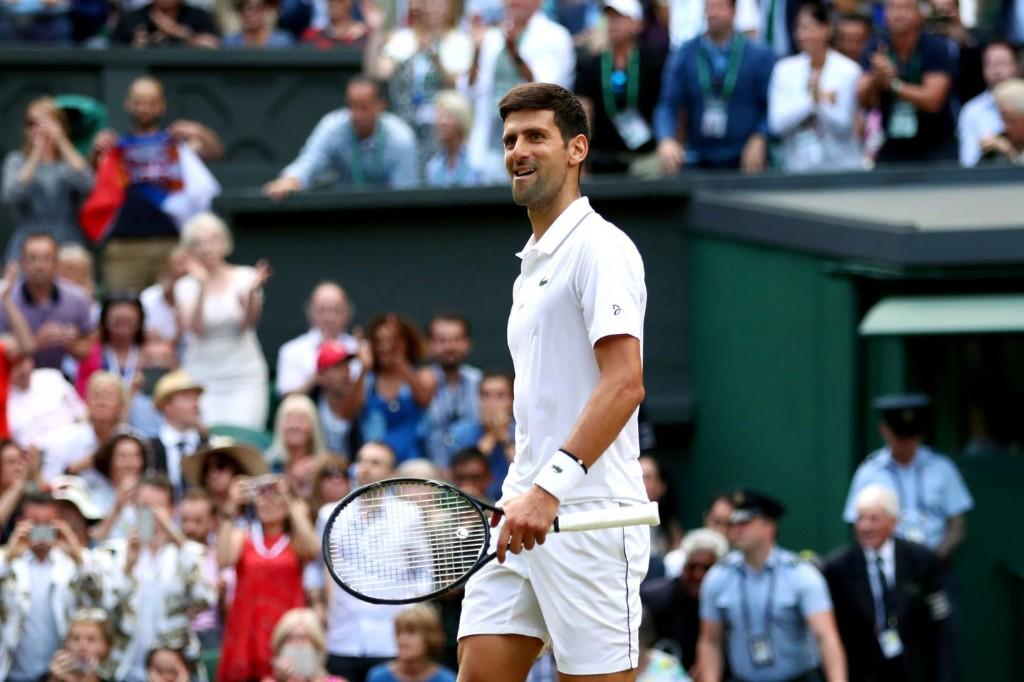 Novak Djokovic beats Roger Federer in marathon fifth set to win second straight Wimbledon title