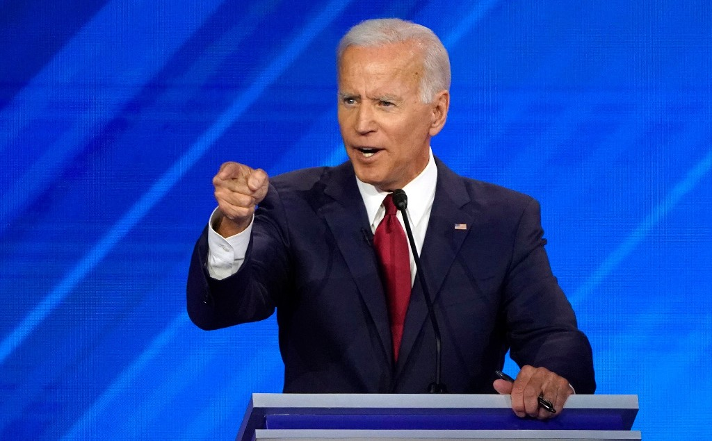 For most of the night, Biden weathers a volley of attacks