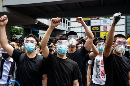 Masks, cash and apps: How Hong Kong's protesters find ways to outwit the surveillance state