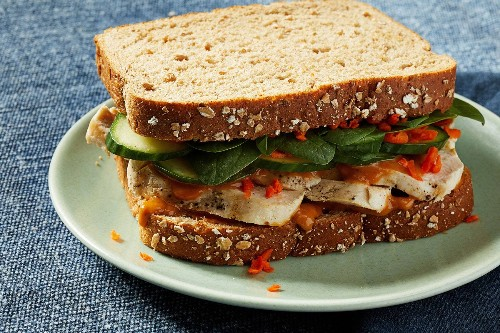 Bold, tangy peanut sauce and crisp vegetables upgrade a chicken sandwich