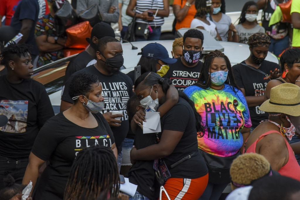 On a D.C. street beset by gun violence, calls to fix policing, not defund it