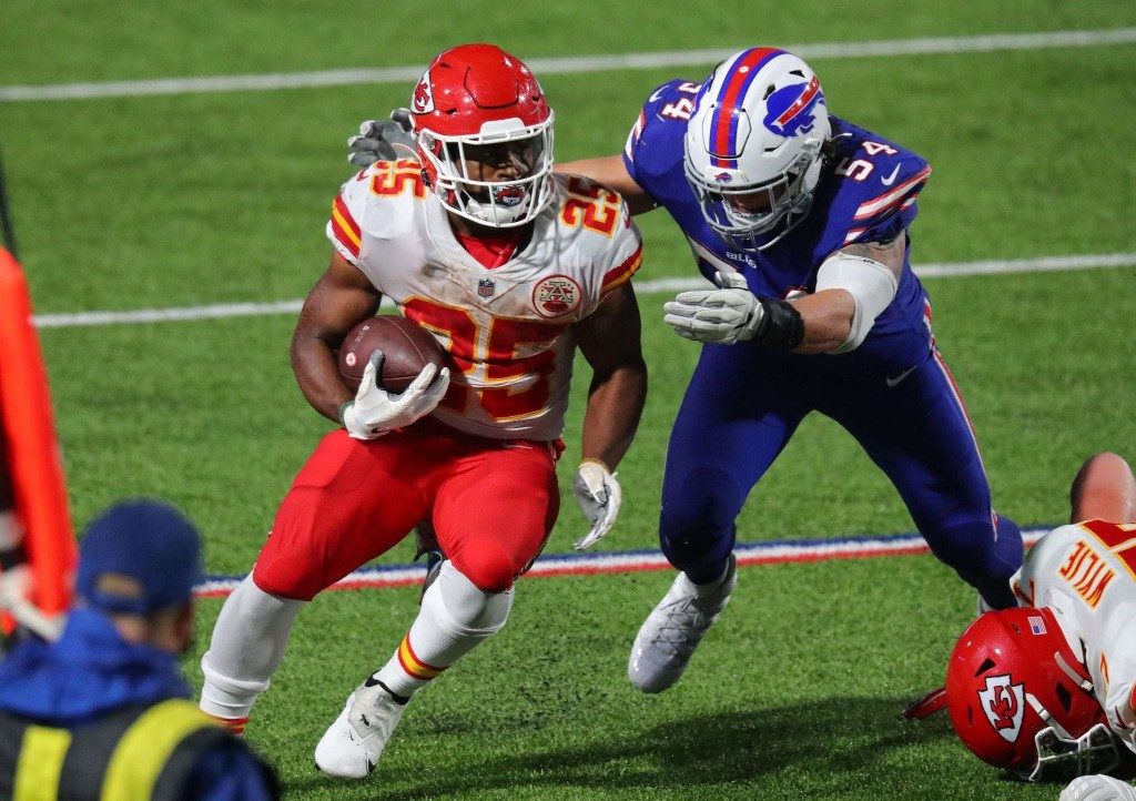 Chiefs show they're more than just Patrick Mahomes, running to a soggy win over the Bills