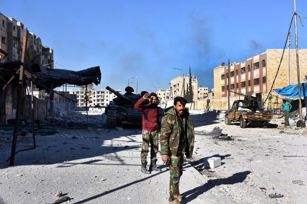 Assad's forces seize a third of rebel-held Aleppo as assault gains momentum