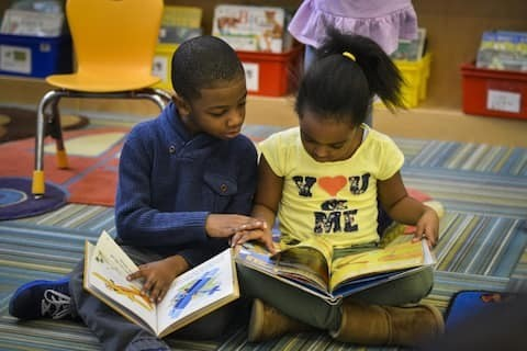 Why kids still need 'real books' to read — and time in school to enjoy them