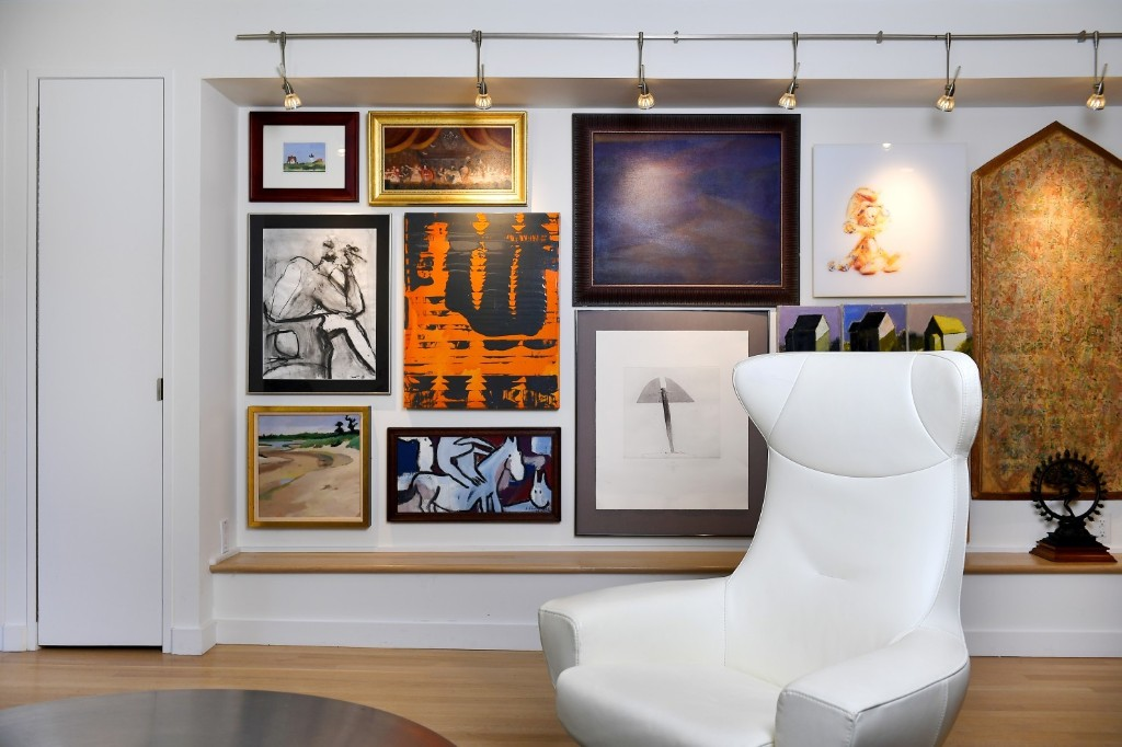An art lover's make-it-work moment: Fitting 40 pieces in his basement apartment