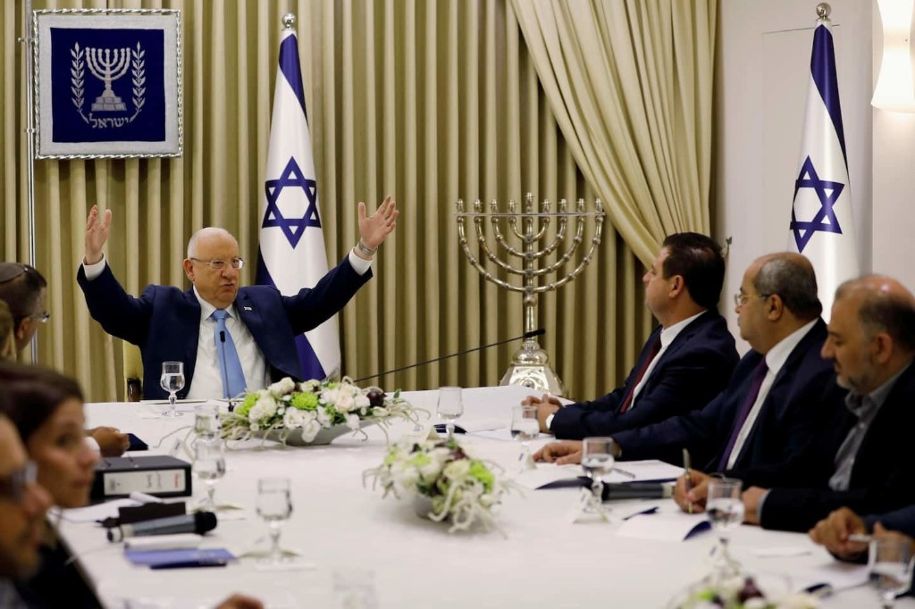 Israeli president summons Netanyahu and his rival Gantz to work out a deal