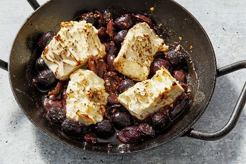 This roasted feta with grapes and olives is a salty, tangy powerhouse of an appetizer — with zero effort