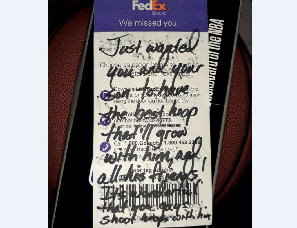 A FedEx driver saw a boy play basketball with a rusty hoop. She went to a store and bought him a new one.