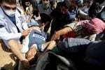 He was wearing a vest marked 'PRESS.' He was shot dead covering a protest in Gaza.