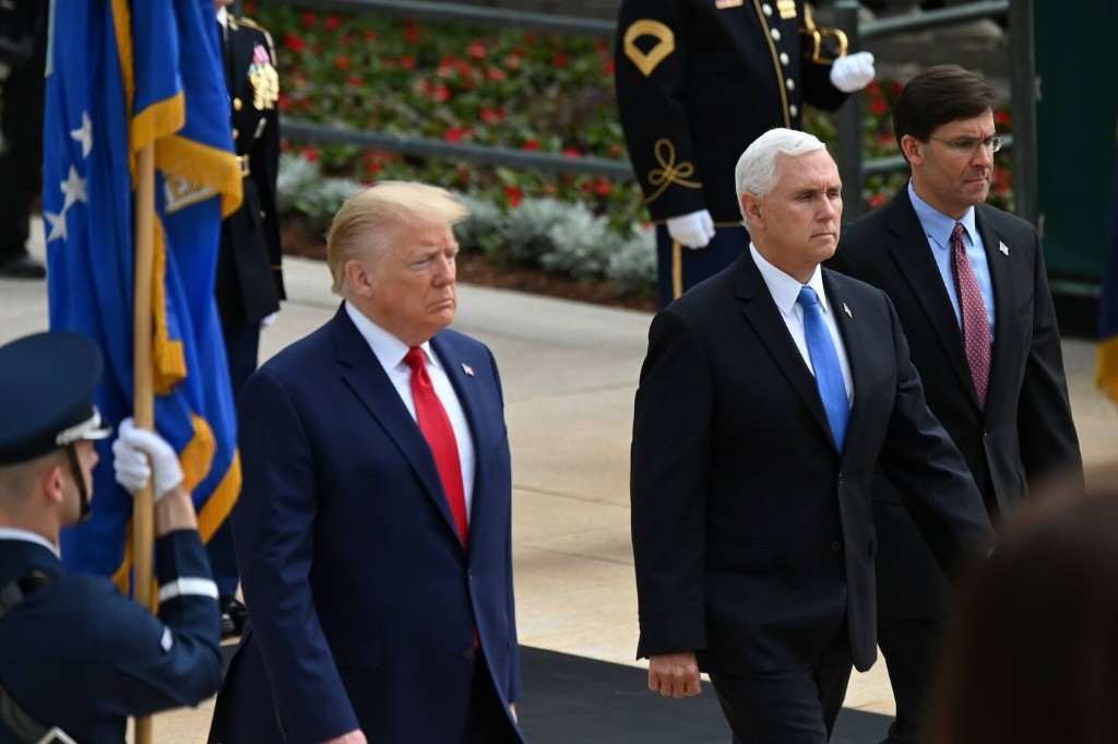 Memorial Day offers array of contrasts as Biden and Trump salute war dead, with and without masks