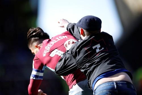 Birmingham City fan runs onto the pitch, attacks Aston Villa's Jack Grealish
