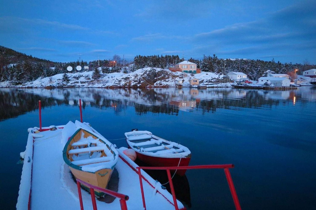 The people of this remote Canadian island village are taking government money to clear out. One couple is staying.