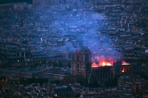 Notre Dame fire: Macron promises to rebuild, but Paris monument suffers 'colossal damage'
