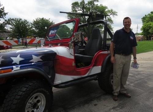 'I will not back down': Kansas Republican defends displaying replica machine gun in parade