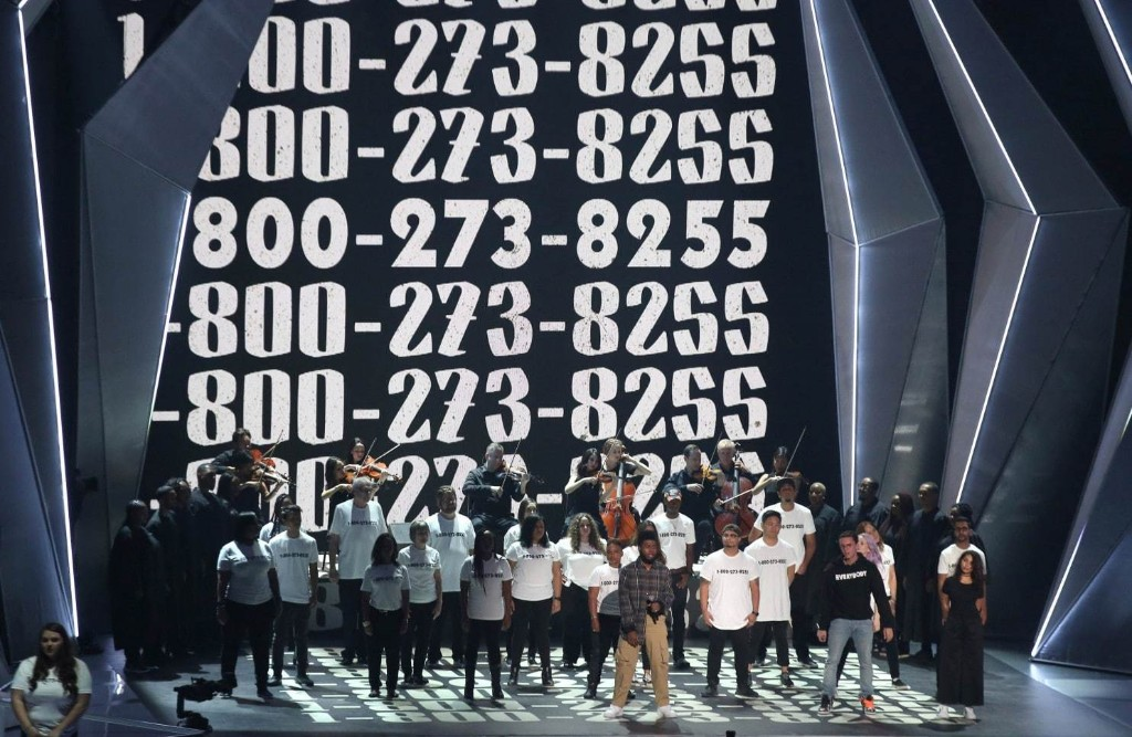 The story behind Logic's powerful suicide prevention anthem '1-800-273-8255'