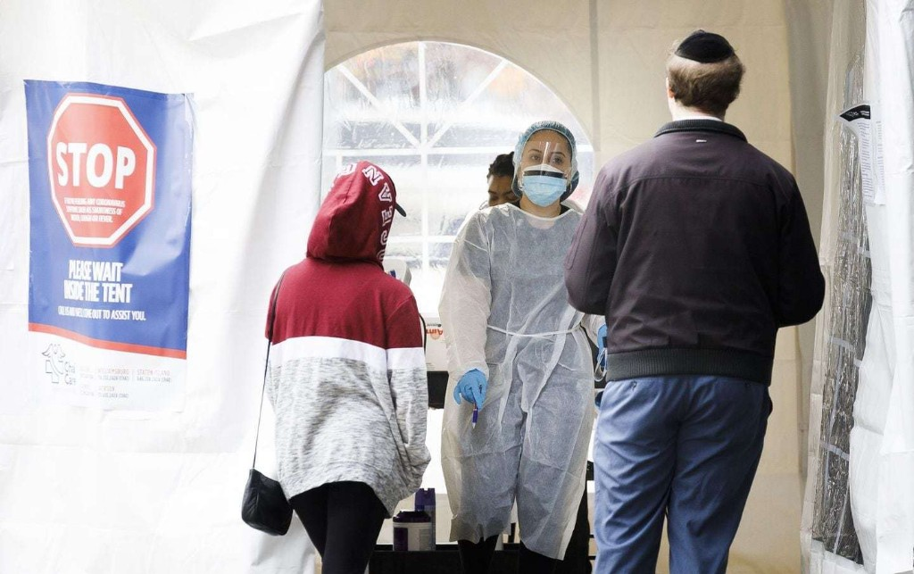 In hard-hit areas, testing restricted to health care workers, hospital patients