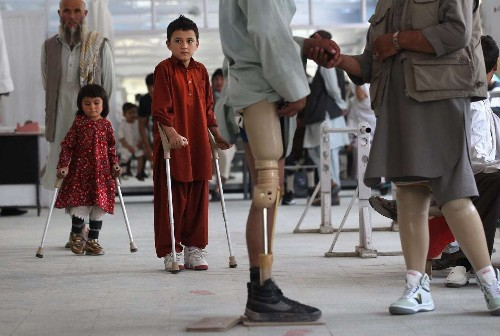 Afghan boy dances with delight after getting new prosthetic leg