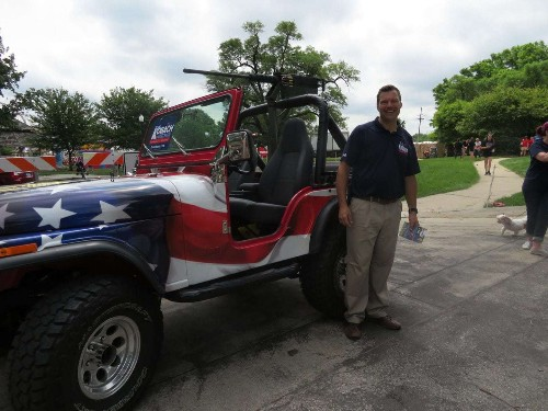 'I will not back down': Kansas Republican defends displaying replica machine gun in parade