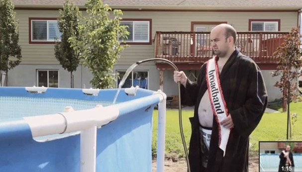 Google Fiber Compared To Broadband By Putting A Middle Age Guy In A Bath Robe And Soaking Him With A Firehose