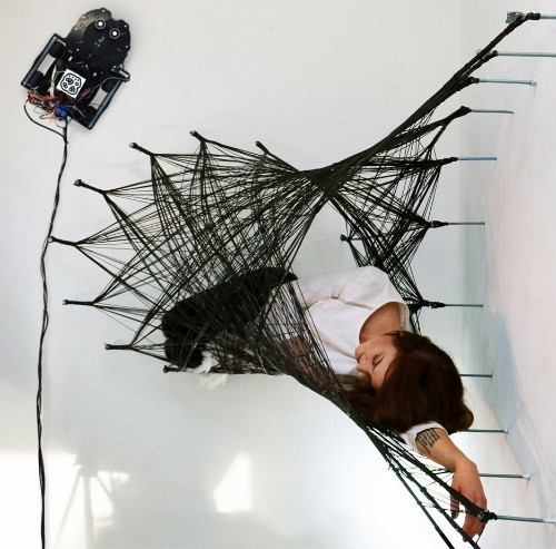 Watch wall-walking spiderbots weave 'impossible' structures with carbon fiber