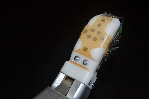 Robots will touch more tenderly when they wear this sensitive skin