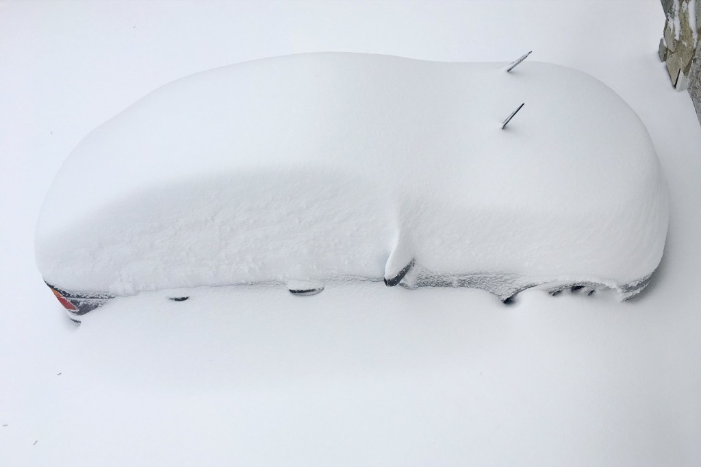 A car is buried in snow inside the Washington DC Beltway in Annandale, Virginia. REUTERS/Hyungwon Kang