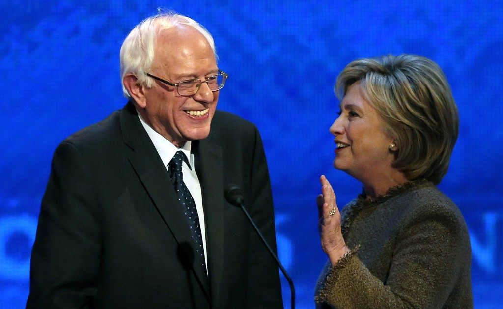 Hillary Clinton speaks to Bernie Sanders during a break at the Democratic presidential primary debate on Dec. 19, 2015, at Saint Anselm College in Manchester, N.H. (AP Photo/Jim Cole)