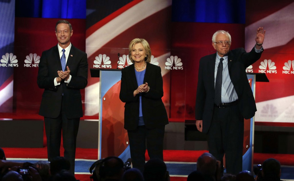 Democratic presidential candidates Martin O'Malley, Hillary Clinton and Bernie Sanders stand together before the start of the NBC, YouTube debate in Charleston, S.C. on Jan. 17, 2016. (AP Photo/Stephen B. Morton)