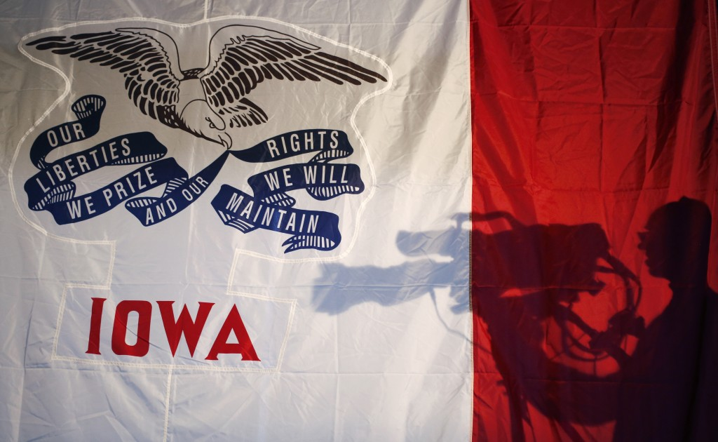 The shadow of a cameraman is cast on an Iowa state flag during a campaign event for Senator Marco Rubio at Iowa State University in Ames on Jan. 30, 2016.  Photographer: Luke Sharrett/Bloomberg via Getty Images