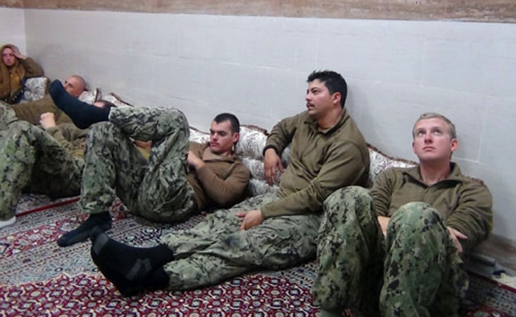 This picture released by the Iranian Revolutionary Guards on Wednesday, Jan. 13, 2016, shows detained American Navy sailors in an undisclosed location in Iran. (Sepahnews via AP)