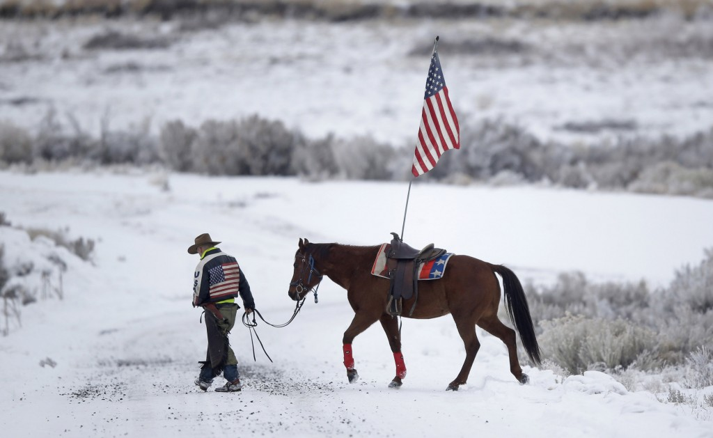 Cowboy Dwane Ehmer, a supporter of the group occupying the Malheur National Wildlife Refuge, walks his horse Thursday, Jan. 7, 2016, near Burns, Ore. (AP Photo/Rick Bowmer)