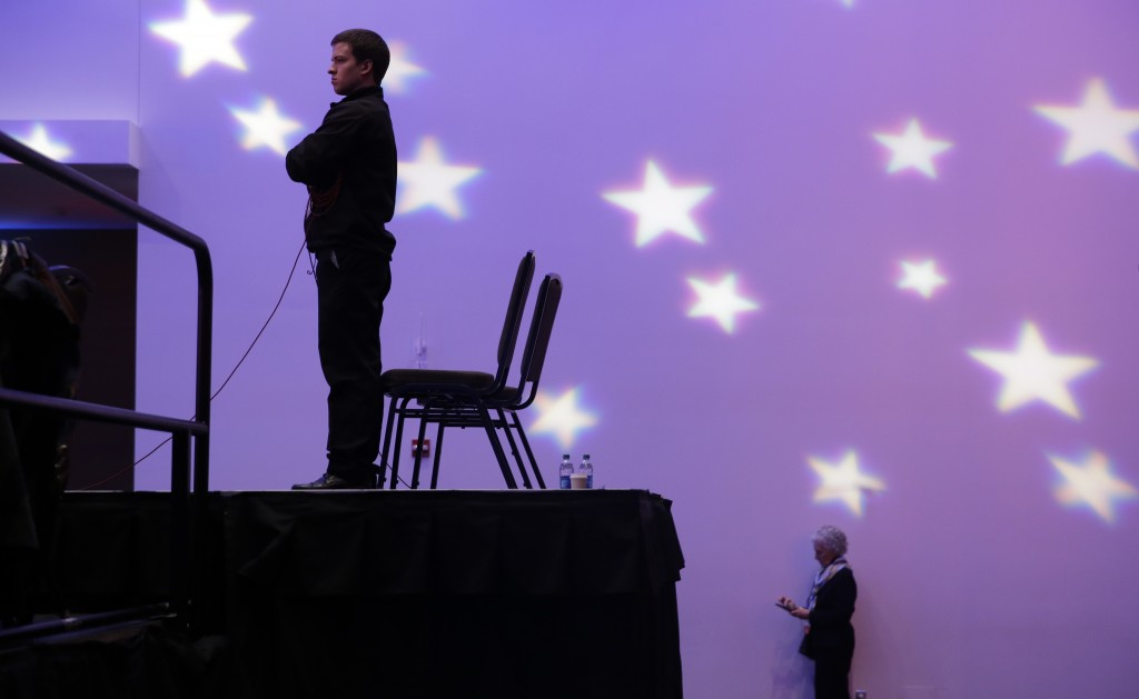 Stage crew watches during the Republican presidential primary debate, Thursday, Jan. 28, 2016, in Des Moines, Iowa. (AP Photo/Chris Carlson)