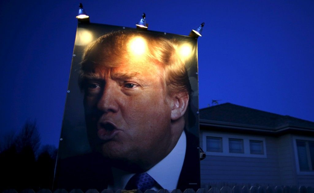A picture of Donald Trump hangs outside a house in West Des Moines, Iowa, January 15, 2016. REUTERS/Jim Young