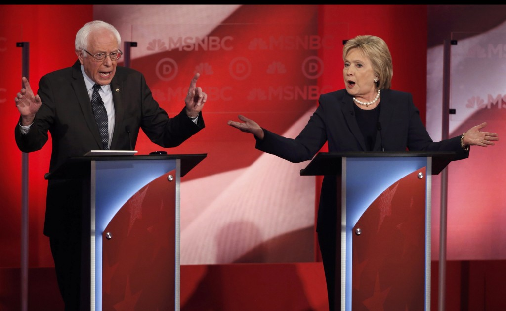 Democratic presidential candidates Senator Bernie Sanders (L) and former Secretary of State Hillary Clinton discuss issues during the presidential candidates debate sponsored by MSNBC at the University of New Hampshire in Durham, New Hampshire, February 4, 2016.  REUTERS/Mike Segar