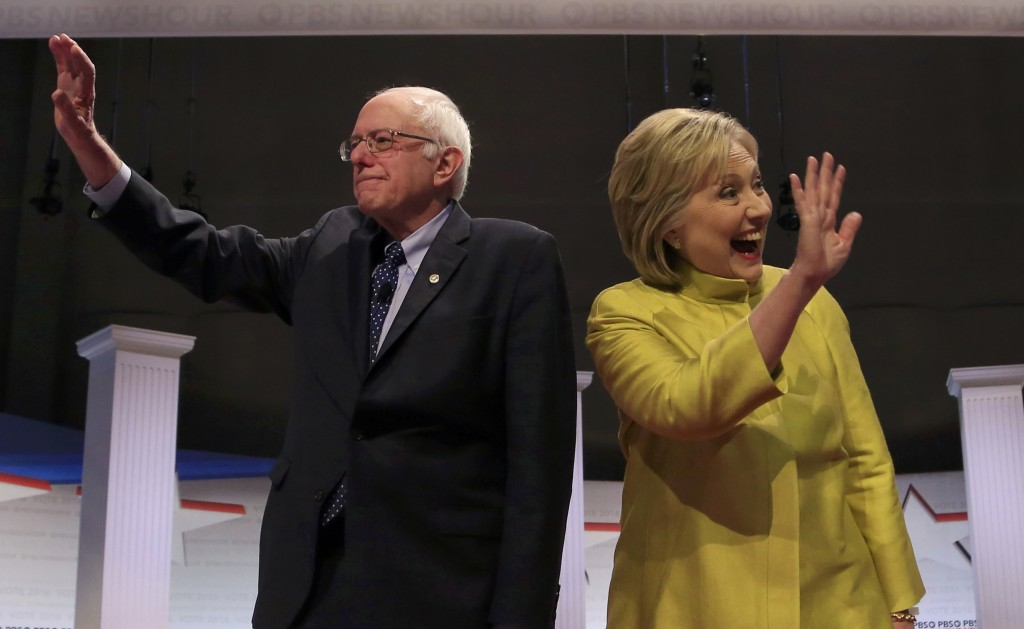Bernie Sanders and Hillary Clinton arrive on stage ahead of the PBS NewsHour Democratic presidential candidates debate in Milwaukee, Wisconsin, February 11, 2016. REUTERS/Darren Hauck