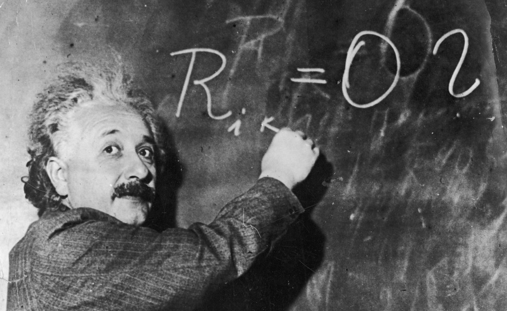 Albert Einstein, inventor of the theory of relativity, writes a mathematical formula on a blackboard. 1930