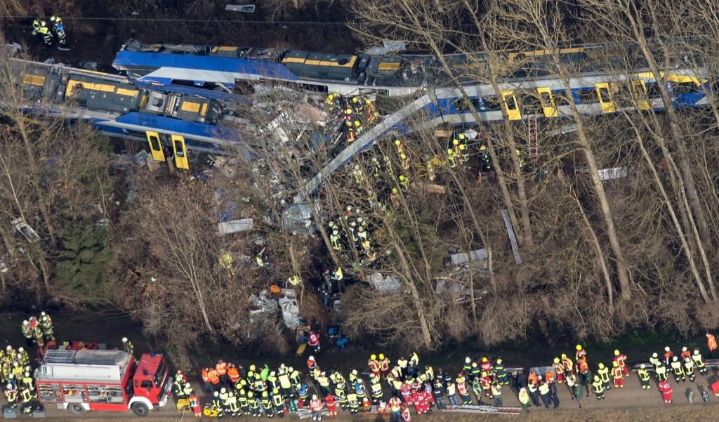Firefighters and emergency doctors work at the site of a train accident near Bad Aibling, southern Germany. PETER KNEFFEL/AFP/Getty Images