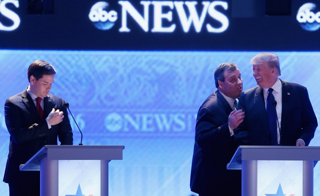Republican presidential candidates New Jersey Governor Chris Christie and Donald Trump visit as Sen. Marco Rubio stands close by during a commercial break in the Republican presidential debate at St. Anselm College February 6, 2016 in Manchester, New Hampshire. (Photo by Joe Raedle/Getty Images)