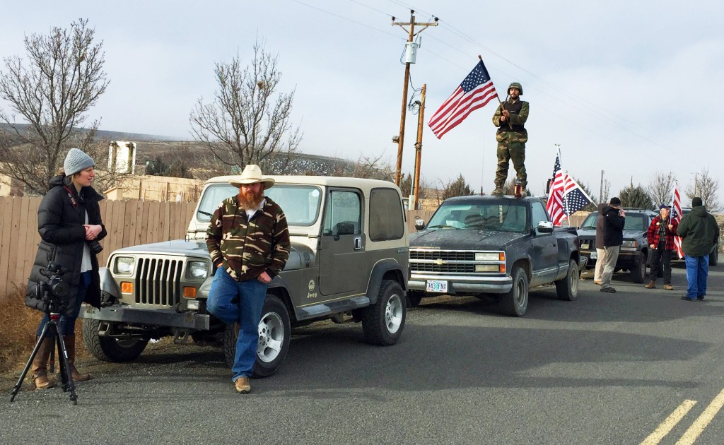 People protesting the FBI action and in support of the armed occupiers of the Malheur National Wildlife Refuge stand outside a roadblock near Burns, Ore., Thursday, Feb. 11, 2016. (AP Photo/Rebecca Boone)