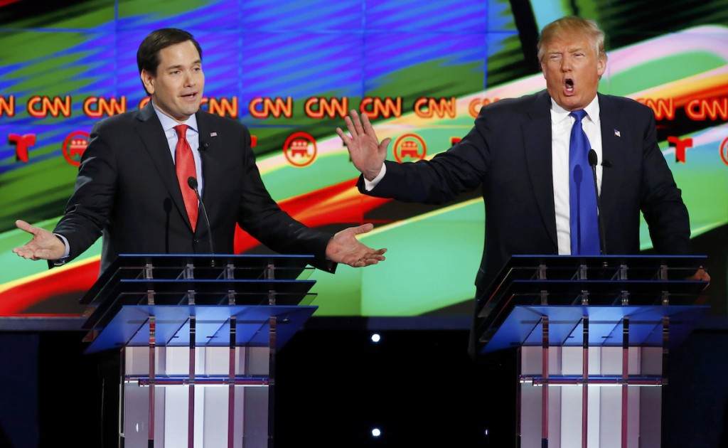 Marco Rubio and Donald Trump speak simultaneously during a Republican U.S. presidential debate  in Houston, Texas, February 25, 2016. REUTERS/Mike Stone