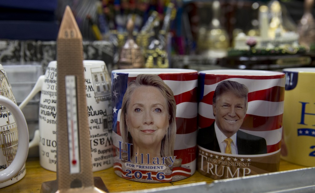 Coffee mugs for sale with the images of Hillary Clinton and Donald Trump sit side by side on a shelf of a souvenir stand at the corner of Constitution Avenue NW and 17th Street NW in Washington, Tuesday, Feb. 16, 2016. (AP Photo/Carolyn Kaster)