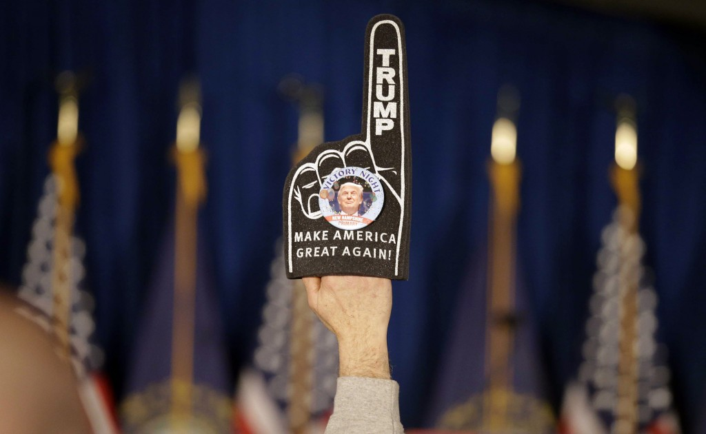 A supporter holds a foam finger sign promoting Republican presidential candidate Donald Trump before he speaks at a primary night rally, Feb. 9, 2016, in Manchester, N.H. (AP Photo/David Goldman)