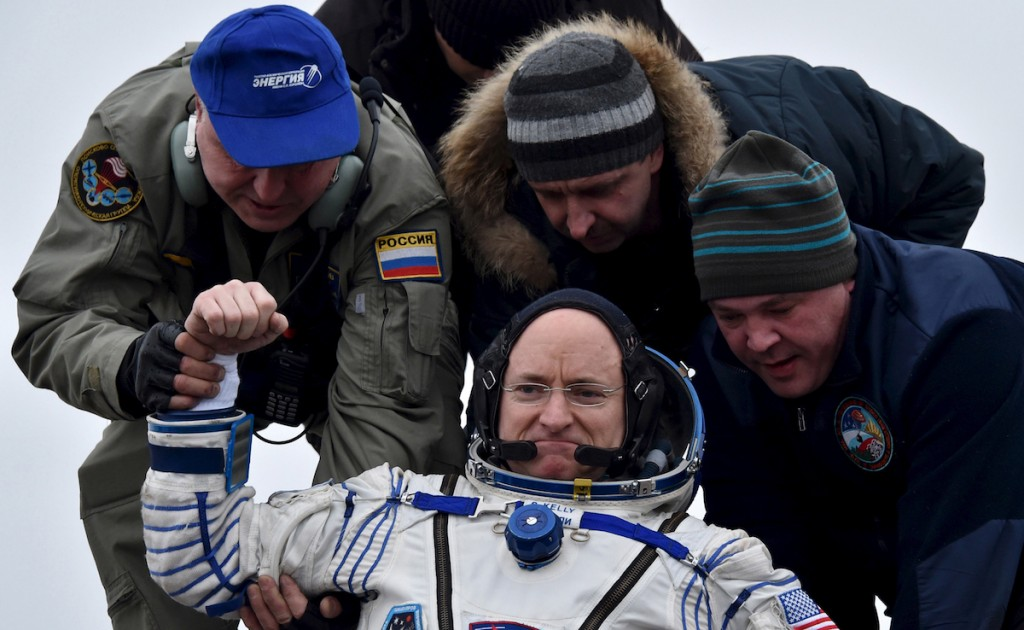 Ground personnel help U.S. astronaut Scott Kelly to get out of a Soyuz capsule shortly after landing near the town of Dzhezkazgan (Zhezkazgan), Kazakhstan, March 2, 2016. REUTERS/Kirill Kudryavtsev/Pool