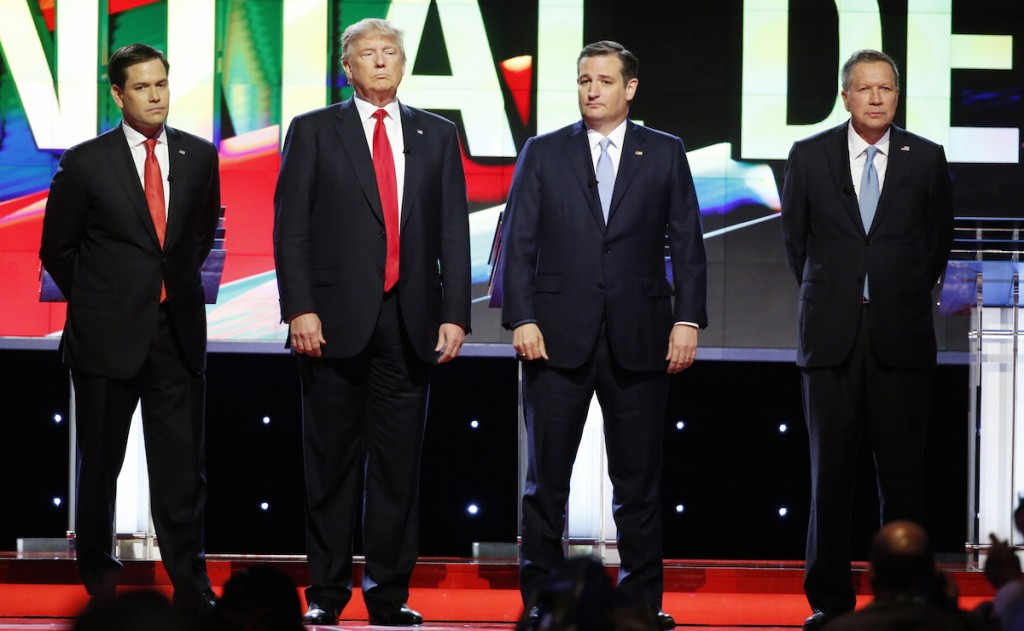 Marco Rubio, Donald Trump, Ted Cruz and Ohio Gov. John Kasich stand together before the start of the Republican presidential debate sponsored by CNN, Salem Media Group and the Washington Times at the University of Miami,  Thursday, March 10, 2016, in Coral Gables, Fla. (AP Photo/Wilfredo Lee)
