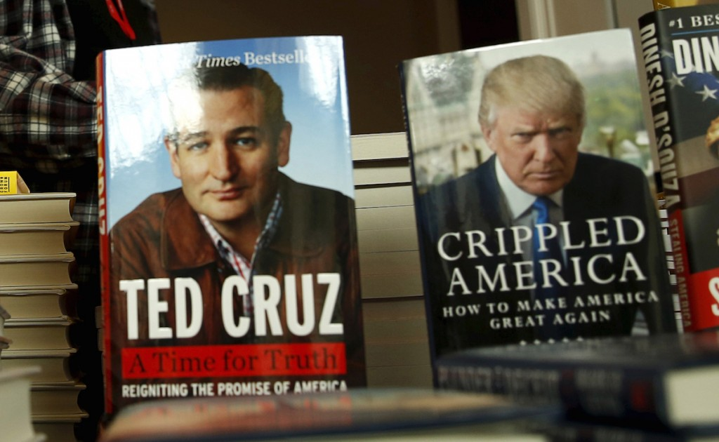 A person browses through books by Republican presidential candidates Ted Cruz and Donald Trump. REUTERS/Gary Cameron