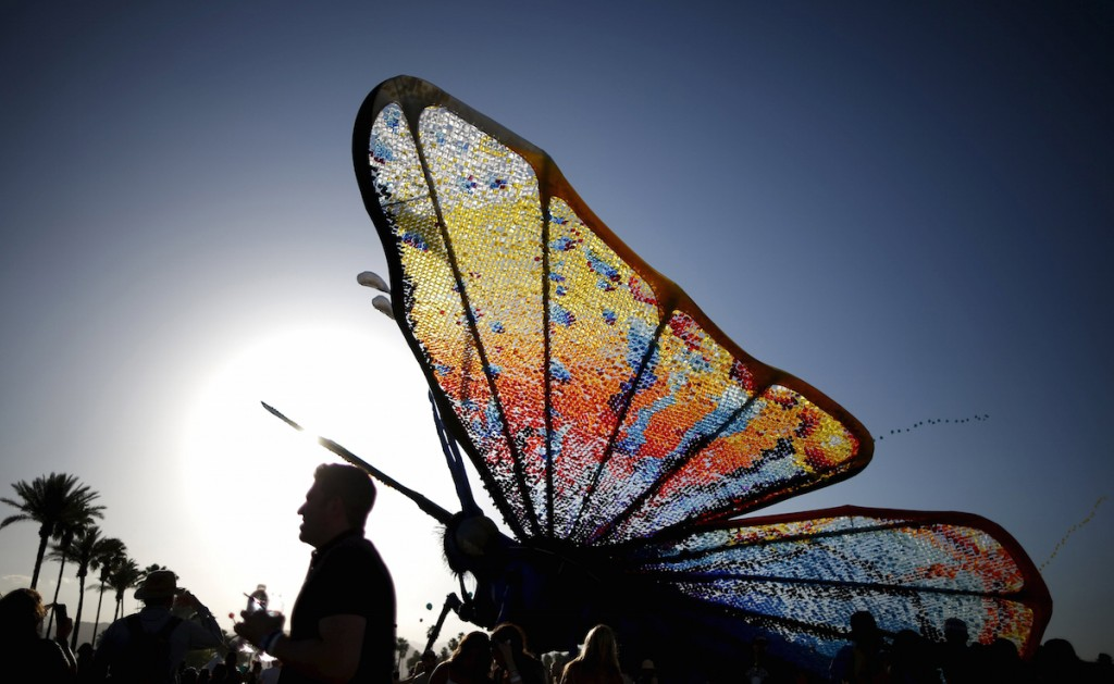 People walk past a butterfly artwork at Coachella 2015. REUTERS/Lucy Nicholson