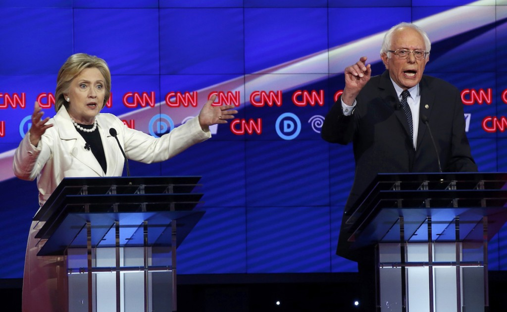 Democratic presidential candidates Hillary Clinton and Bernie Sanders speak simultaneously during a Democratic debate in New York April 14, 2016. REUTERS/Lucas Jackson